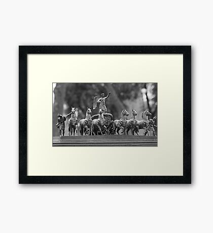 horses in a chariot sculpture Framed Print