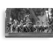 horses in a chariot sculpture Canvas Print