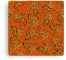 Red Squirrels on a brown background. Canvas Print