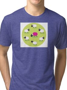 One pink sheep is lonely in the middle of white sheep family Tri-blend T-Shirt