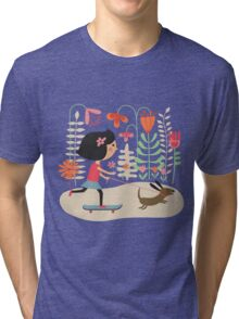 Girl on skateboard with her dog Tri-blend T-Shirt