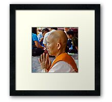 Nun Praying. Framed Print