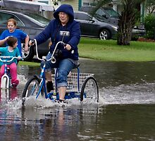 KB on Bike in Flood.jpg by TJ Baccari Photography