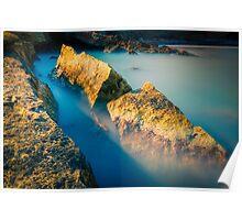 Rocks and misty blue ocean Poster