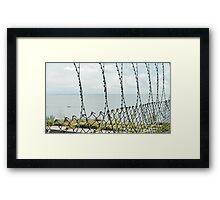Sea behind barbed wire  Framed Print