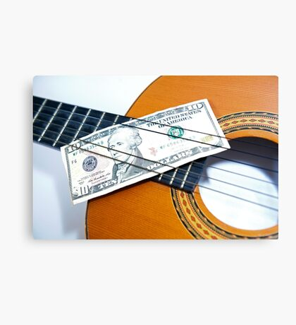 Acoustic guitar and 10 dollar note. Notes on notes. Canvas Print