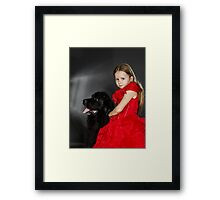 Beauty and the Beast. Little girl with big black water-dog portrait, isolated on grey Framed Print