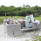 Laundry on the Musi in Hyderabad by Andrew  Makowiecki