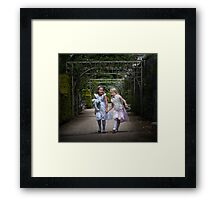 Young girls in a park Framed Print