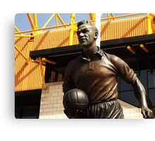 statue out side a football stadium Canvas Print