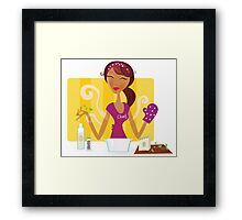 Woman is cooking meal in the kitchen. Sexy woman chef is preparing dinner in the kitchen. Framed Print