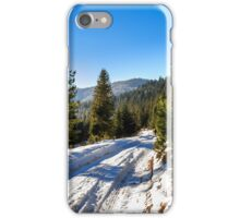 road to mountain forest in winter iPhone Case/Skin