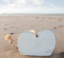 alone wooden love heart in the sand by morrbyte