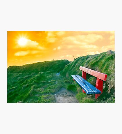 bench on a cliff edge at sunset Photographic Print