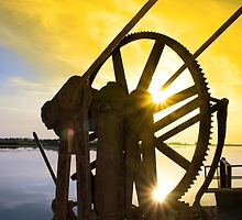 crane gears on Salleen pier with sunset by morrbyte