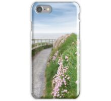 pink wild flowers along a cliff walk path iPhone Case/Skin