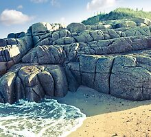 rock formation on a coastal beach in county Donegal by morrbyte