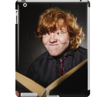 Freckled red-haired teenage boy reading book, education concept, isolated on black background iPad Case/Skin