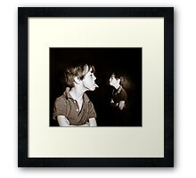 Double-exposed portrait of red-haired freckled boy, dark background Framed Print