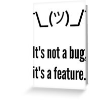 Shrug It's not a bug, it's a feature. Black Text Programmer Excuse Design Greeting Card