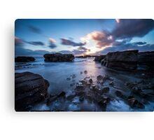 Sunset on the shoreline Canvas Print