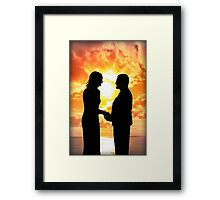 young loving couple holding hands in silhouette Framed Print