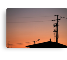 roofs at sunset Canvas Print