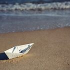 Paper boat on a beach by DonatellaLoi