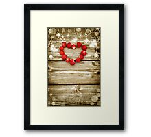 Old grunge wooden board with light bulb border, strawberry in the shape of a heart. Framed Print