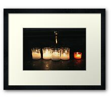 candles in the church Framed Print