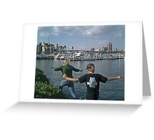 Two peas in a pod - skipping in the rocks in Long Beach, CA (Check out the brothers' shirt) Greeting Card