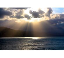 Sun rays over water Photographic Print
