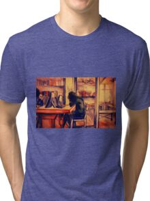 Watercolor of girl studying in a cafe or library  Tri-blend T-Shirt