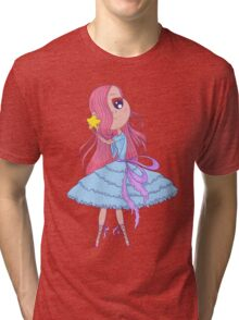 Cute anime ballerina with pink hair in tutu holding in her hands star. Tri-blend T-Shirt