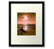 Surfer meets the sunrise over the beach Framed Print