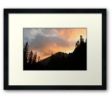 Cloudy sunset over the mountains Framed Print