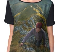 Hiker with backpack on mountains Chiffon Top