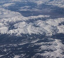 Flying Over the Snow Covered Rocky Mountains by Georgia Mizuleva
