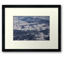 Flying Over the Snow Covered Rocky Mountains Framed Print