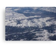 Flying Over the Snow Covered Rocky Mountains Canvas Print