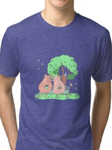Couple of cute pigs sitting on a bench under a tree Tri-blend T-Shirt