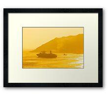 Cargo ship under sunset Framed Print
