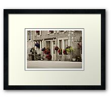 Flowers in the streets Framed Print