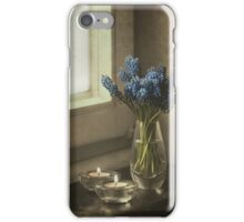 Still life with blue flowers and candles iPhone Case/Skin