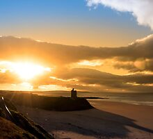 yellow sunshine over the Ballybunion beach and castle by morrbyte