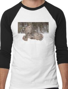 Great grey owl in flight over a snow covered field T-Shirt