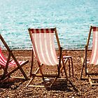 Stripy Deckchairs Pebble Beach Sea and Sunshine by Natalie Kinnear