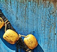 fender, ropes and rust, detail of a ship by travel4pictures