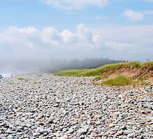 Fog Rolling In On Beach Filled With Pebbles by AlySmyphoto1