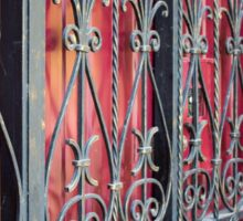 Detail of an old building with an iron fence Sticker